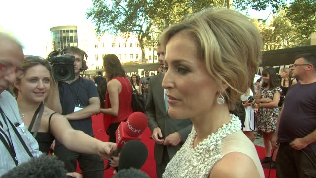 Gillian Anderson on being terrible at keeping secrets at the Johnny English Reborn UK Premiere at London England