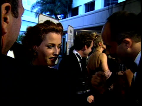 gillian anderson stops to speak with a reporter on the red carpet - gillian anderson stock videos & royalty-free footage