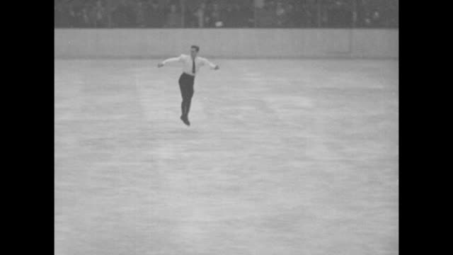 gillis grafstrom swedish figure skater warming up for figure skating routine in olympic arena / grafstrom performing routine / grafstrom performing... - 1932 winter olympics lake placid stock videos and b-roll footage