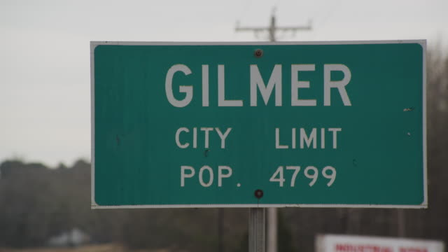 Gilmer, Texas city limits highway sign. Population 4799.