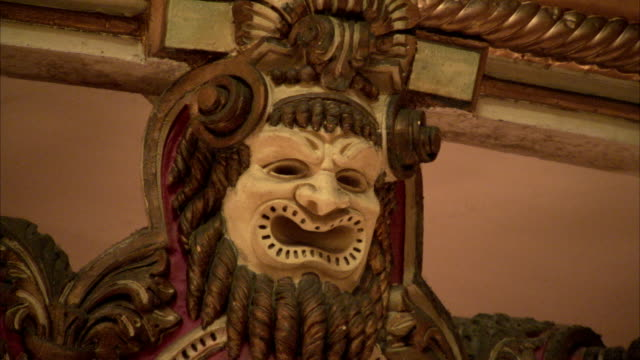 a gilt-edged wooden face adorns a balcony in the amazon theatre.. available in hd. - amazonas state brazil stock videos and b-roll footage