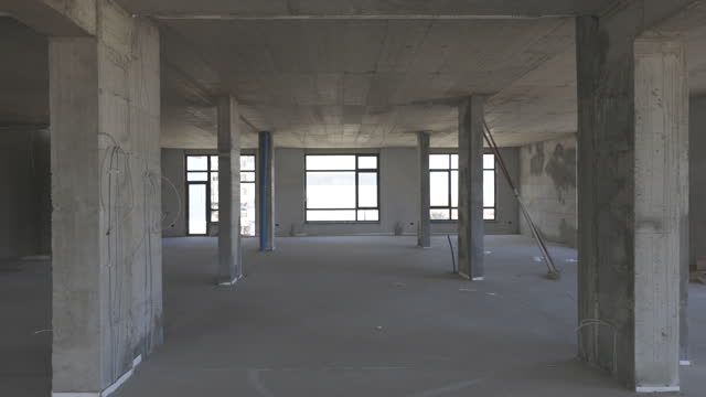 gimbal shoot of large office area in construction - incomplete stock videos & royalty-free footage