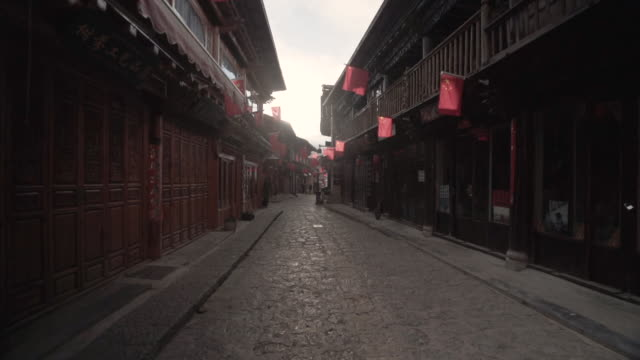 gimbal walking at shangri-la chinese ancient town - old town stock videos & royalty-free footage