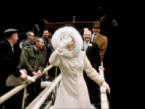 ginger rogers dances down the gangplank of the qe2 and waves to photographers and fans after arriving at southampton for her west end run in mame 1968 - warm clothing stock videos & royalty-free footage