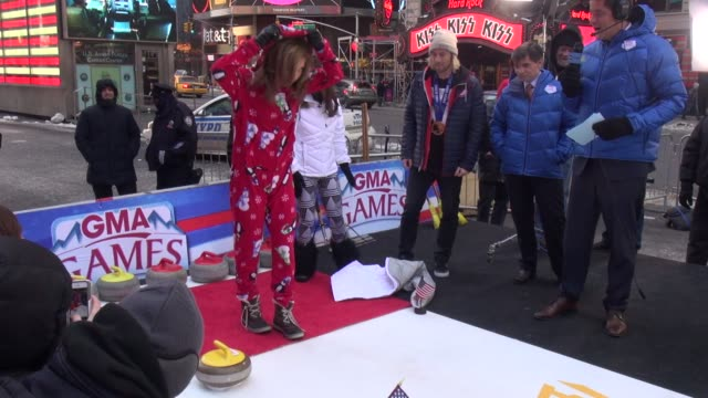 ginger zee curling on the outside set of the good morning america show - celebrity sightings in new york on february 12, 2014 in new york city. - ginger zee stock videos & royalty-free footage