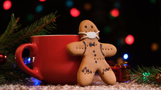 gingerbread cookie wearing mask - christmas decoration stock videos & royalty-free footage