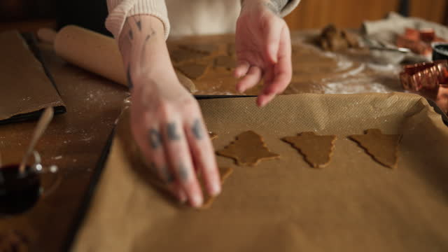 gingerbread cookies on baking sheet - baking tray stock videos & royalty-free footage