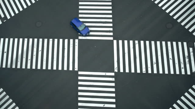 ginza cross top view car moving in tokyo japan - zebra crossing stock videos and b-roll footage