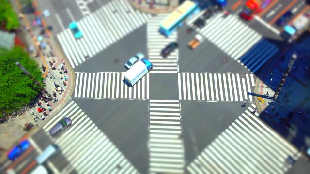 ginza pedestrian crossing in tokyo /tilt-shift - tilt shift stock videos & royalty-free footage