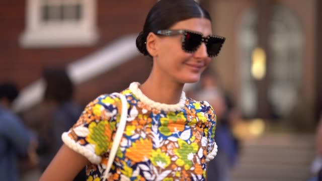 giovanna battaglia wears a colored floral print dress sunglasses a bag brown sandals during london fashion week september 2019 on september 14 2019... - floral pattern stock videos & royalty-free footage