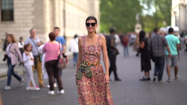 giovanna battaglia wears sunglasses, an off-shoulder dress with printed geometrical patterns, a green tactical belt with attached pockets, black... - trainer stock videos & royalty-free footage