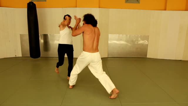 girl against two men - self defence stock videos & royalty-free footage