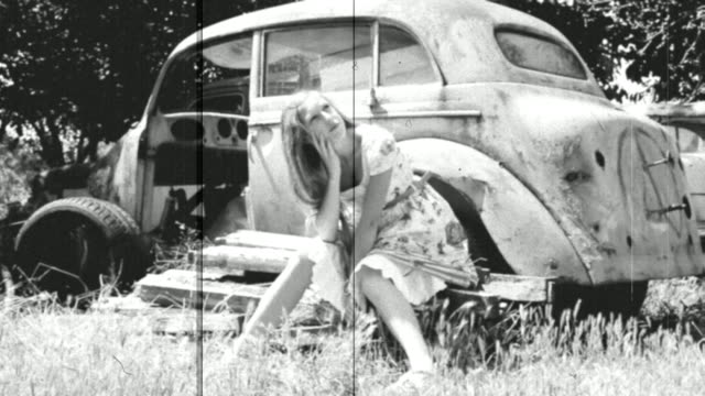 girl and an old car