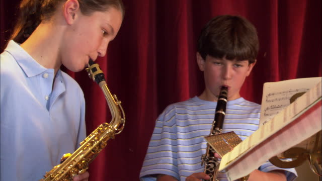 girl and boy playing instruments during school band practice / los angeles, california - clarinet stock videos & royalty-free footage