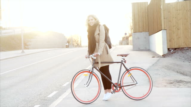 Girl and her bike in the sunset
