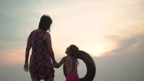 a girl and her grandmother standing at beach - braided hair stock videos & royalty-free footage