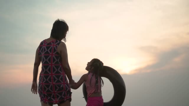 a girl and her grandmother standing at beach - braided hair stock videos and b-roll footage