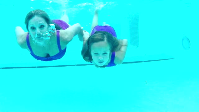 girl and her grandmother swimming underwater - swimwear stock videos and b-roll footage