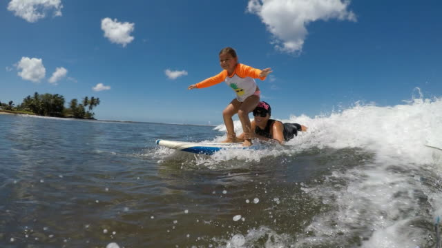 a girl and her mom try surfing in hawaii. - cool attitude stock videos & royalty-free footage