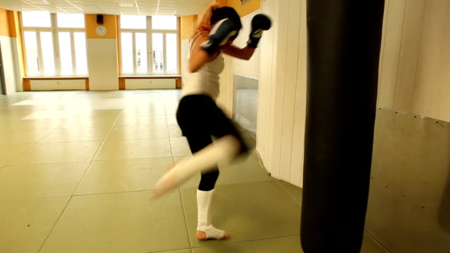 girl and quarterback sack - kickboxing stock videos and b-roll footage