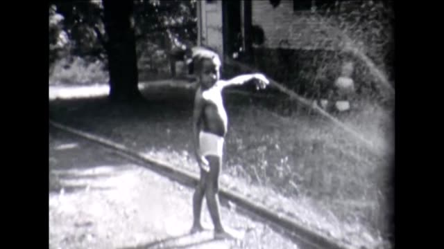 1955 girl and sprinkler - african ethnicity stock videos & royalty-free footage