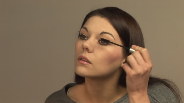 girl applying make up (mascara) hd & pal - mascara stock videos and b-roll footage