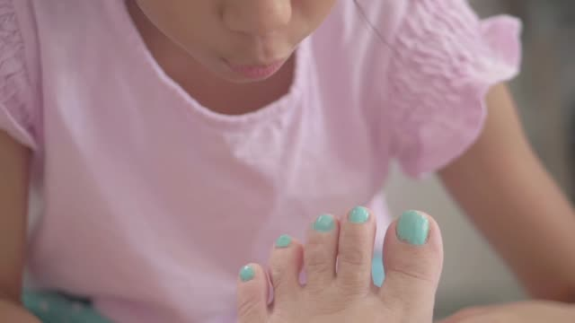 girl applying nail painting for her mother, while stay at home. - painting toenails stock videos & royalty-free footage