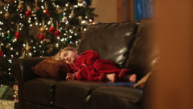 girl asleep on the couch waiting for santa claus - sleeping stock videos & royalty-free footage