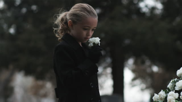 girl at a funeral - putting stock videos & royalty-free footage