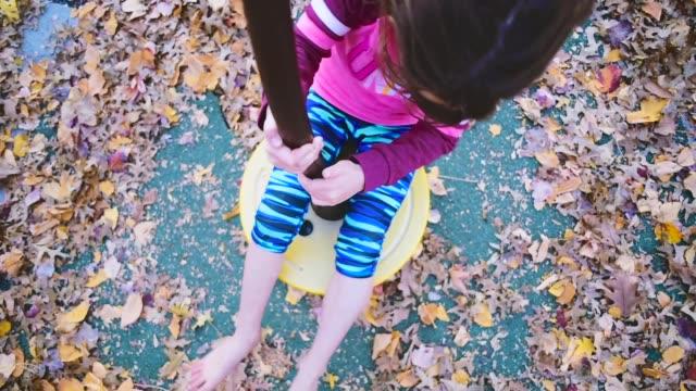 girl at a park. - endast flickor bildbanksvideor och videomaterial från bakom kulisserna