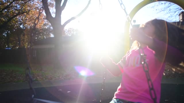 girl at a park. - tyre swing stock videos & royalty-free footage