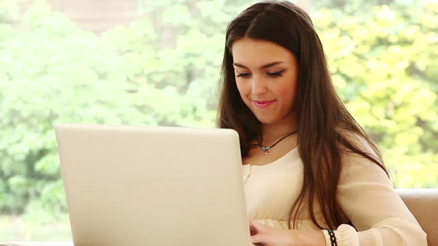 Girl at home with laptop.