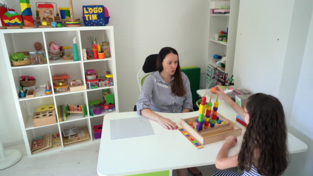 girl at occupational therapy session with mental health professional's office - invisible disability stock videos & royalty-free footage