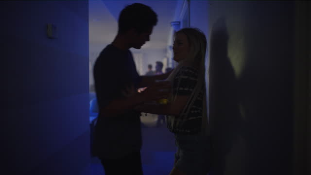 girl at party walking away from aggressive flirting boy at party / cedar hills, utah, united states - freundin stock-videos und b-roll-filmmaterial