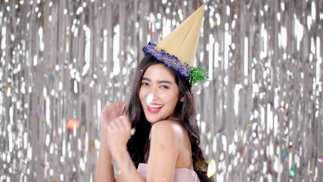 girl at the party in a celebratory cap on a background. - little girls flashing stock videos and b-roll footage