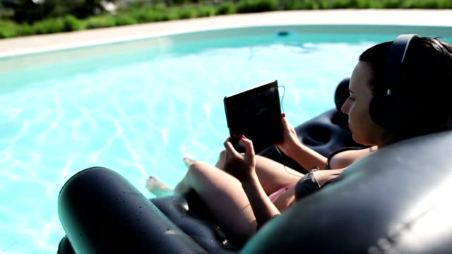 girl at the swimming pool with digital tablet - inflatable stock videos and b-roll footage
