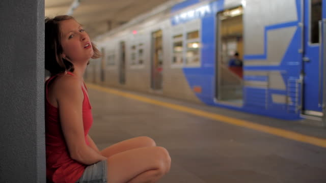 girl at train station - sulking stock videos & royalty-free footage