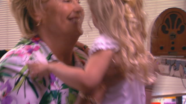 girl being hugged by grandma - lipstick kiss stock videos and b-roll footage