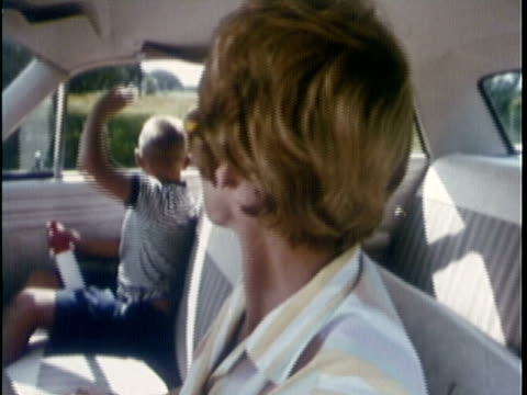 1969 MONTAGE Girl being picked up at playground by her mother in car, mother with son and daughter in car / Rockport, Texas, USA
