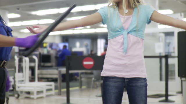 ms girl (10-11) being searched by airport security / jacksonville, florida, usa - security staff stock videos & royalty-free footage