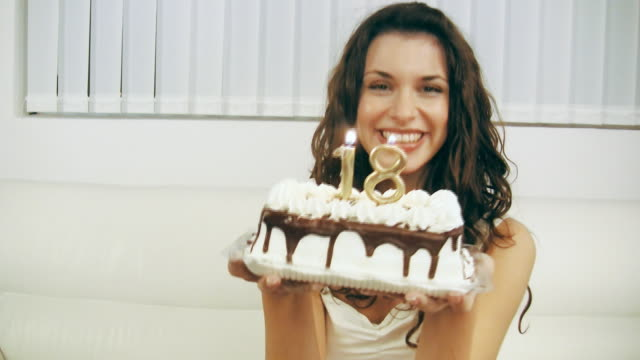 girl blowing birthday cake candles 18 (hd video) - 18 19 years stock videos & royalty-free footage