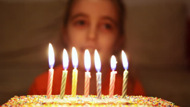 hd: girl blowing birthday cake candles - birthday candles stock videos and b-roll footage