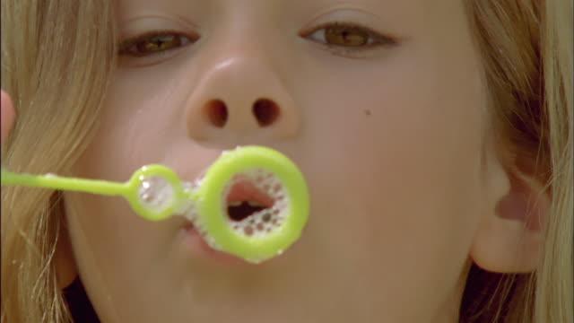 ECU, Girl (6-7) blowing bubbles, Chateau du Parc, Saint Ferme, France