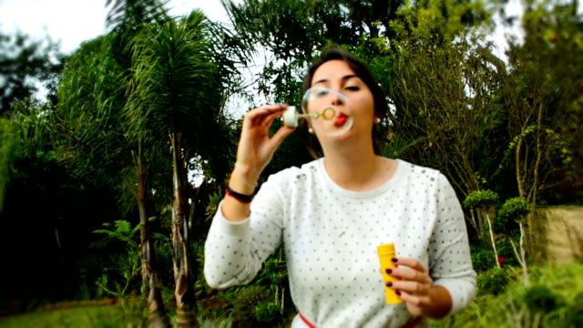 girl blowing bubbles - only young women stock videos & royalty-free footage