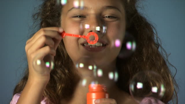 girl blowing bubbles - see other clips from this shoot 1162 stock videos & royalty-free footage