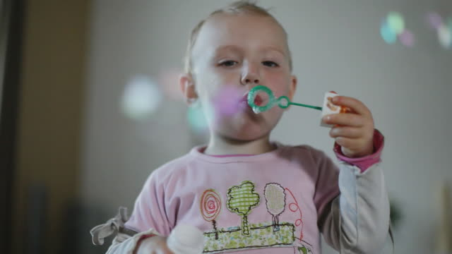 CU Girl (12-23 months) blowing bubbles with bubble wand / Potsdam, Brandenburg, Germany