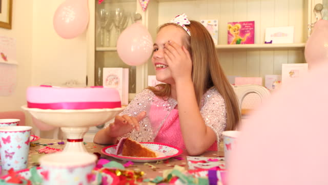girl blowing out candles and eating her birthday cake - shy stock videos & royalty-free footage