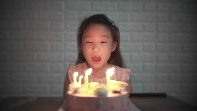 slo mo girl blowing out candles on a birthday cake on her birthday - birthday candle stock videos & royalty-free footage
