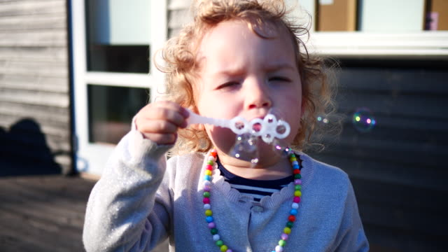 girl blowning bubbles - denmark stock videos & royalty-free footage