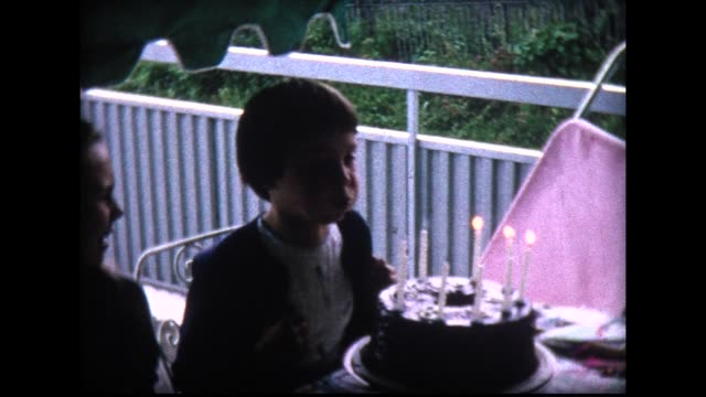 1965 girl blows out candles from revolving birthday cake - home movie stock videos & royalty-free footage